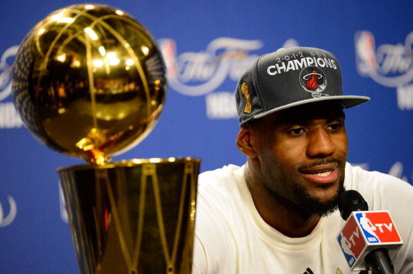 MIAMI, FL - JUNE 21:  LeBron James #6 of the Miami Heat answers questions from the media next to the Larry O'Brien Finals Championship trophy during his post game press conference after they won 121-106 against the Oklahoma City Thunder in Game Five of the 2012 NBA Finals on June 21, 2012 at American Airlines Arena in Miami, Florida. NOTE TO USER: User expressly acknowledges and agrees that, by downloading and or using this photograph, User is consenting to the terms and conditions of the Getty Images License Agreement.  (Photo by Ronald Martinez/Getty Images)