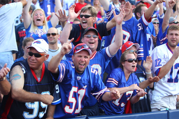 ORCHARD PARK, NY - SEPTEMBER 25: Fans of the Buffalo Bills celebrate a victory over the New England Patriots at Ralph Wilson Stadium on September 25, 2011 in Orchard Park, New York. (Photo by Tom Szczerbowski/Getty Images)