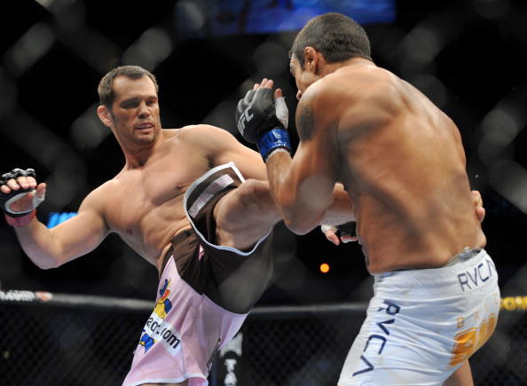 DALLAS - SEPTEMBER 19:  UFC fighter Vitor Belfort (R) battles UFC fighter Rich Franklin (L) during their Catch weight bout at UFC 103: Franklin vs. Belfort at the American Airlines Center on September 19, 2009 in Dallas, Texas.  (Photo by Jon Kopaloff/Getty Images)