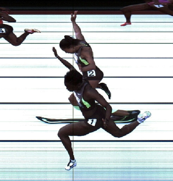 EUGENE, OR - JUNE 23:  In this handout photo provided by the USTF, Jeneba Tarmoh (bottom, lane 1) and Allyson Felix cross the finish line at exactly the same time in the women's 100 meter dash final during Day Two of the 2012 U.S. Olympic Track & Field Team Trials at Hayward Field on June 23, 2012 in Eugene, Oregon. The USTF is still determining how to break the tie. Only one of the women will make the Olympic team.  (Photo by USTF/Getty Images)
