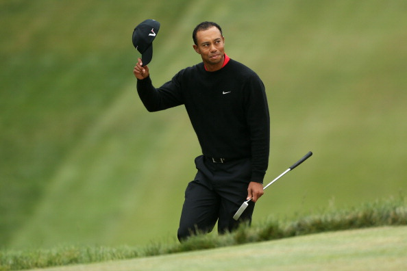 SAN FRANCISCO, CA - JUNE 17:  Tiger Woods of the United States waves to the gallery on the 18th green during the final round of the 112th U.S. Open at The Olympic Club on June 17, 2012 in San Francisco, California.  (Photo by Andrew Redington/Getty Images)