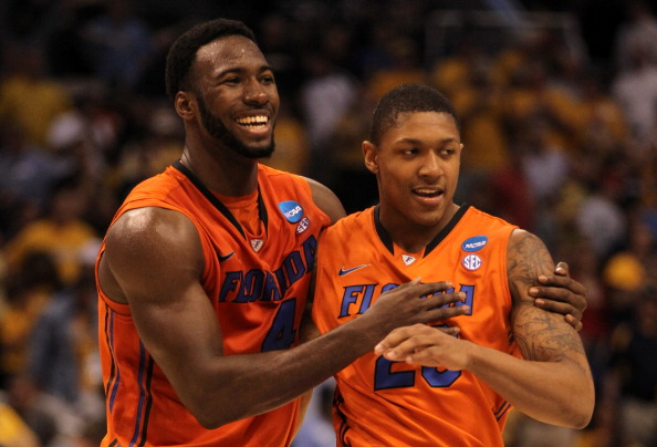 PHOENIX, AZ - MARCH 22:  Patric Young #4 and Bradley Beal #23 of the Florida Gators celebrate the 68-58 victory against the Marquette Golden Eagles during the 2012 NCAA Men's Basketball West Regional Semifinal game at US Airways Center on March 22, 2012 in Phoenix, Arizona.  (Photo by Jamie Squire/Getty Images)