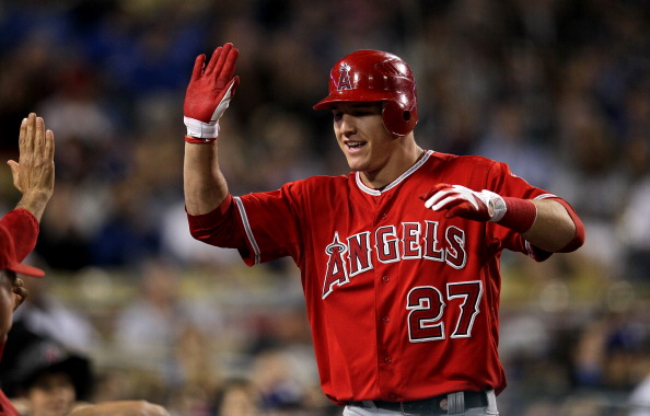 LOS ANGELES, CA - JUNE 11:  Mike Trout #27 of the Los Angeles Angels of Anaheim celebrates as he returns to the dugout after hitting a solo home run in the fourth inning against the Los Angeles Dodgers on June 11, 2012 at Dodger Stadium in Los Angeles, California.  (Photo by Stephen Dunn/Getty Images)