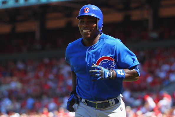 ST. LOUIS, MO - MAY 15: Alfonso Soriano #12 of the Chicago Cubs returns to the dugout after hitting a game-tying home run against the St. Louis Cardinals at Busch Stadium on May 15, 2012 in St. Louis, Missouri.  (Photo by Dilip Vishwanat/Getty Images)