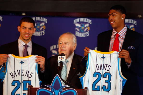 NEW ORLEANS, LA - JUNE 29:  Austin Rivers #25, team owner Tom Benson, and Anthony Davis #23 of the New Orleans Hornets pose as they are introduced to the media at the New Orleans Areana on June 29, 2012 in New Orleans, Louisiana. Davis was the first overall pick, and Rivers the 10th overall pick in the 2012 NBA draft.  (Photo by Chris Graythen/Getty Images)
