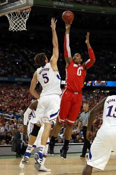 NEW ORLEANS, LA - MARCH 31:  Jared Sullinger #0 of the Ohio State Buckeyes shoots the ball over Jeff Withey #5 of the Kansas Jayhawks in the first half during the National Semifinal game of the 2012 NCAA Division I Men's Basketball Championship at the Mercedes-Benz Superdome on March 31, 2012 in New Orleans, Louisiana.  (Photo by Jeff Gross/Getty Images)