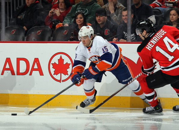 NEWARK, NJ - APRIL 03: P.A. Parenteau #15 of the New York Islanders skates against the New Jersey Devils at the Prudential Center on April 3, 2012 in Newark, New Jersey. The Devils defeated the Islanders 3-1.  (Photo by Bruce Bennett/Getty Images)