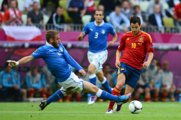 GDANSK, POLAND - JUNE 10: Antonio Cassano of Italy tackles Cesc Fabregas of Spain during the UEFA EURO 2012 group C match between Spain and Italy at The Municipal Stadium on June 10, 2012 in Gdansk, Poland.  (Photo by Shaun Botterill/Getty Images)