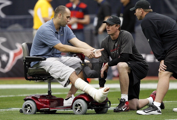 HOUSTON, TX - DECEMBER 04:  Quarterback Matt Schaub of the Houston Texans talks with quarterback Matt Ryan, center, of the Atlanta Falcons as he takes the field in his motorized cart during pre-game warm ups before the Houston Texans play the Atlanta Falcons at Reliant Stadium on December 4, 2011 in Houston, Texas. Schaub recently had season ending foot surgery.  (Photo by Bob Levey/Getty Images)