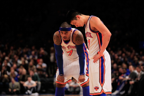 NEW YORK, NY - FEBRUARY 20: Carmelo Anthony #7 and Jeremy Lin #17 of the New York Knicks stand on the court against the New Jersey Nets at Madison Square Garden on February 20, 2012 in New York City. NOTE TO USER: User expressly acknowledges and agrees that, by downloading and/or using this Photograph, user is consenting to the terms and conditions of the Getty Images License Agreement.  (Photo by Chris Trotman/Getty Images)
