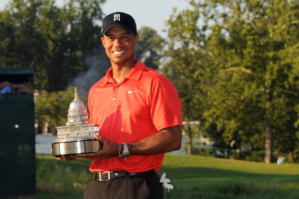 BETHESDA, MD - JULY 01:  Tiger Woods poses with the winner's trophy after winning the AT&T National at Congressional Country Club on July 1, 2012 in Bethesda, Maryland.  (Photo by Patrick McDermott/Getty Images)