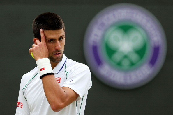 LONDON, ENGLAND - JULY 04:  Novak Djokovic of Serbia looks on during his Gentlemen's Singles quarter final match against Florian Mayer of Germany on day nine of the Wimbledon Lawn Tennis Championships at the All England Lawn Tennis and Croquet Club on July 4, 2012 in London, England.  (Photo by Julian Finney/Getty Images)