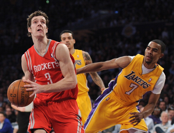 LOS ANGELES, CA - APRIL 06:  Goran Dragic #3 of the Houston Rockets heads to the basket past Ramon Sessions #7 of the Los Angeles Lakers during a 112-107 Rockets win at Staples Center on April 6, 2012 in Los Angeles, California.  NOTE TO USER: User expressly acknowledges and agrees that, by downloading and or using this photograph, User is consenting to the terms and conditions of the Getty Images License Agreement.  (Photo by Harry How/Getty Images)