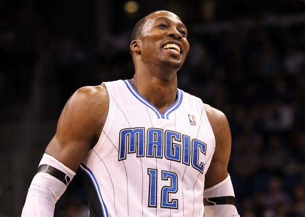 ORLANDO, FL - MARCH 13:  Dwight Howard #12 of the Orlando Magic smiles during the game against the Miami Heat at Amway Center on March 13, 2012 in Orlando, Florida.  NOTE TO USER: User expressly acknowledges and agrees that, by downloading and or using this photograph, User is consenting to the terms and conditions of the Getty Images License Agreement.  (Photo by Sam Greenwood/Getty Images)