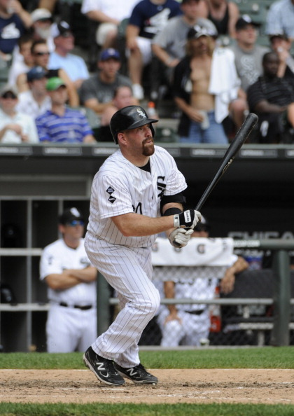 CHICAGO, IL - JULY 05: Kevin Youkilis #20 of the Chicago White Sox hits a solo home run in the sixth inning against the Texas Rangers on July 5, 2012 at U.S. Cellular Field in Chicago, Illinois. The Chicago White Sox defeated the Texas Rangers 2-1.  (Photo by David Banks/Getty Images)