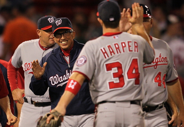 BOSTON, MA - JUNE 8: Davey Johnson #5 of the Washington Nationals and Bryce Harper #34 of the Washington Nationals celebrate a win over the Boston Red Sox at Fenway Park June 8, 2012  in Boston, Massachusetts.  (Photo by Jim Rogash/Getty Images)