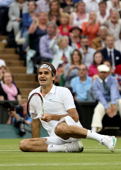 LONDON, ENGLAND - JULY 08:  Roger Federer of Switzerland celebrates match point during his Gentlemen's Singles final match against Andy Murray of Great Britain on day thirteen of the Wimbledon Lawn Tennis Championships at the All England Lawn Tennis and Croquet Club on July 8, 2012 in London, England.  (Photo by Clive Brunskill/Getty Images)