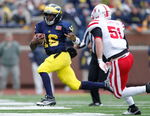 ANN ARBOR, MI - NOVEMBER 19: Denard Robinson #16 of the Michigan Wolverines tries to get around the pursuit of Will Compton #51 of the Nebraska Cornhuskers at Michigan Stadium on November 19, 2011 in Ann Arbor, Michigan. (Photo by Gregory Shamus/Getty Images)