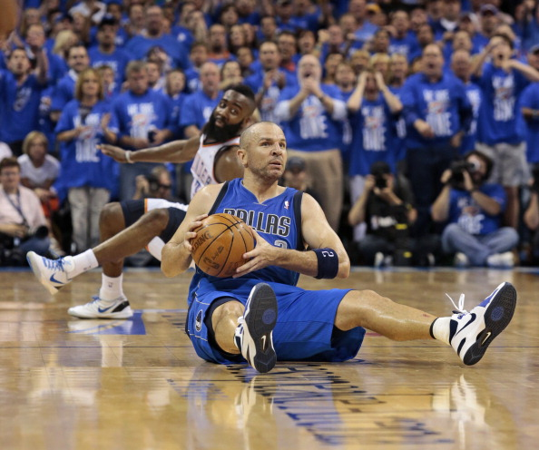 OKLAHOMA CITY, OK - APRIL 28:  Jason Kidd #2 of the Dallas Mavericks recovers a ball as James Harden #13 of the Oklahoma City Thunder slides past in Game One of the Western Conference Quarterfinals in the 2012 NBA Playoffs on April 28, 2012 at the Chesapeake Energy Arena in Oklahoma City, Oklahoma. Oklahoma City defeated Dallas 99-98. NOTE TO USER: User expressly acknowledges and agrees that, by downloading and or using the photograph, User is consenting to the terms and conditions of the Getty Images License Agreement. (Photo by Brett Deering/Getty Images)