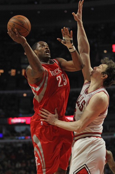 CHICAGO, IL - APRIL 02:  Marcus Camby #29 of the Houston Rockets shoots against Omer Asik #3 of the Chicago Bulls at the United Center on April 2, 2012 in Chicago, Illinois. The Rockets defeated the Bulls 99-93. NOTE TO USER: User expressly acknowledges and agrees that, by downloading and or using this photograph, User is consenting to the terms and conditions of the Getty Images License Agreement.  (Photo by Jonathan Daniel/Getty Images)