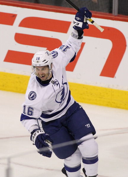 WINNIPEG, CANADA - APRIL 7: Teddy Purcell #16 of the Tampa Bay Lightning celebrates a goal against the Winnipeg Jets in NHL action at the MTS Centre on April 7, 2012 in Winnipeg, Manitoba, Canada. (Photo by Marianne Helm/Getty Images)