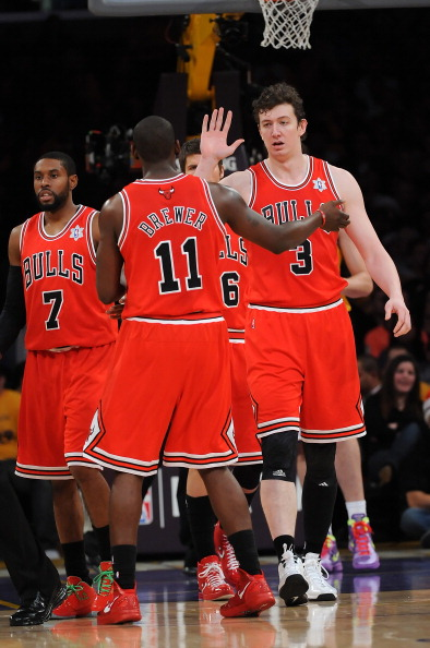 LOS ANGELES - DECEMBER 25:   Omer Asik #3 celebrates with teammate Ronnie Brewer #11 of the Chicago Bulls during the game against the Los Angeles Lakers at Staples Center on December 25, 2011 in Los Angeles, California.  NOTE TO USER: User expressly acknowledges and agrees that, by downloading and or using this photograph, User is consenting to the terms and conditions of the Getty Images License Agreement.  (Photo by Lisa Blumenfeld/Getty Images)
