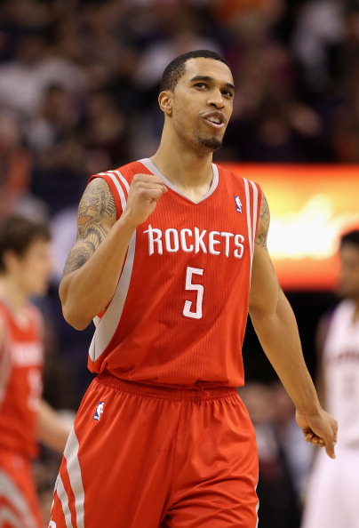 PHOENIX, AZ - FEBRUARY 09:  Courtney Lee #5 of the Houston Rockets celebrates during the NBA game against the Phoenix Suns at US Airways Center on February 9, 2012 in Phoenix, Arizona. The Rockets defeated the Suns 96-89. NOTE TO USER: User expressly acknowledges and agrees that, by downloading and or using this photograph, User is consenting to the terms and conditions of the Getty Images License Agreement.  (Photo by Christian Petersen/Getty Images)