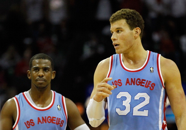 CHARLOTTE, NC - FEBRUARY 11:  Teammates Chris Paul #3 of the Los Angeles Clippers and Blake Griffin #32 walk down the court against the Charlotte Bobcats during their game at Time Warner Cable Arena on February 11, 2012 in Charlotte, North Carolina. NOTE TO USER: User expressly acknowledges and agrees that, by downloading and or using this photograph, User is consenting to the terms and conditions of the Getty Images License Agreement.  (Photo by Streeter Lecka/Getty Images)