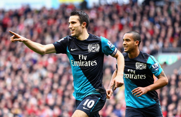 LIVERPOOL, ENGLAND - MARCH 03:  Robin van Persie of Arsenal celebrates scoring the equalising goal with teaammate Theo Walcott (R) during the Barclays Premier League match between Liverpool and Arsenal at Anfield on March 3, 2012 in Liverpool, England.  (Photo by Clive Mason/Getty Images)