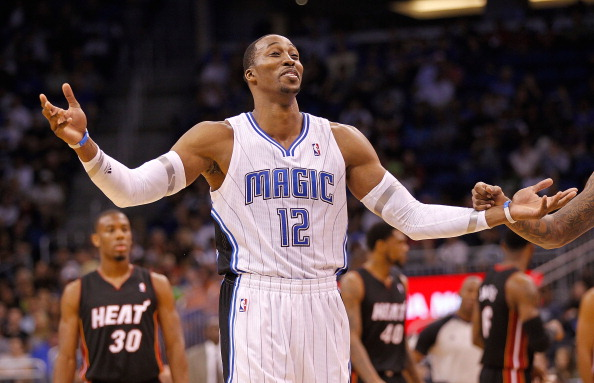 ORLANDO, FL - DECEMBER 21: Dwight Howard #12 of the Orlando Magic argues a call during a preseason game against the Miami Heat at Amway Center on December 21, 2011 in Orlando, Florida. NOTE TO USER: User expressly acknowledges and agrees that, by downloading and/or using this Photograph, User is consenting to the terms and conditions of the Getty Images License Agreement.  (Photo by Mike Ehrmann/Getty Images)