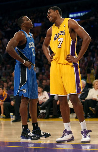 LOS ANGELES - JANUARY 16:  Andrew Bynum #17 of the Los Angeles Lakers and Dwight Howard #12 of the Orlando Magic look on during a break in their NBA game on January 16, 2009 at Staples Center in Los Angeles, California. The Magic won 109-103.   NOTE TO USER: User expressly acknowledges and agrees that, by downloading and/or using this Photograph, user is consenting to the terms and conditions of the Getty Images License Agreement. (Photo by Stephen Dunn/Getty Images)