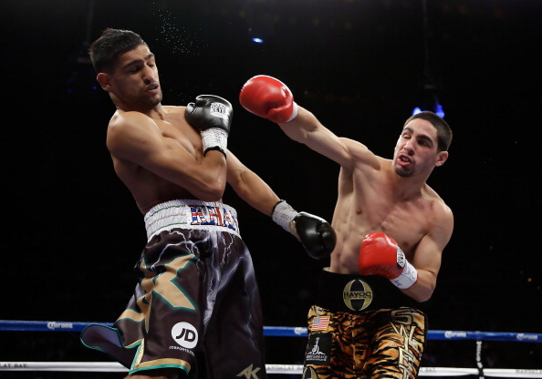 LAS VEGAS, NV - JULY 14:  Danny Garcia (R) throws a right hand at Amir Khan of Great Britain during their WBC/ WBA Super Lightweight and vacant Ring Magazine Junior Welterweight title fight at Mandalay Bay Events Center on July 14, 2012 in Las Vegas, Nevada.  (Photo by Jeff Gross/Getty Images)