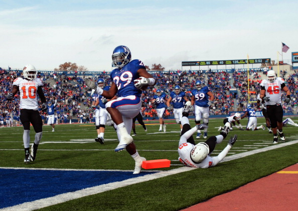 LAWRENCE, KS - NOVEMBER 20:  Running back James Sims #29 of the Kansas Jayhawks carries the ball in for a touchdown during the game against the Oklahoma State Cowboys on November 20, 2010 at Memorial Stadium in Lawrence, Kansas.  (Photo by Jamie Squire/Getty Images)