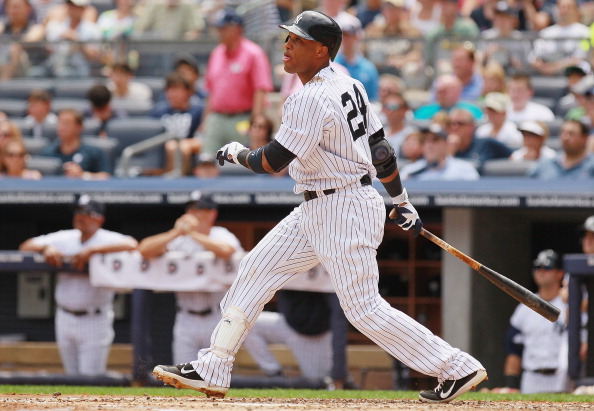 NEW YORK, NY - JULY 14:  Robinson Cano #24 of the New York Yankees watches his first-inning two-run homer in the first inning against the Los Angeles Angels of Anaheim at Yankee Stadium on July 14, 2012 in the Bronx borough of New York City. Yankees defeated the Angels 5-3.  (Photo by Mike Stobe/Getty Images)
