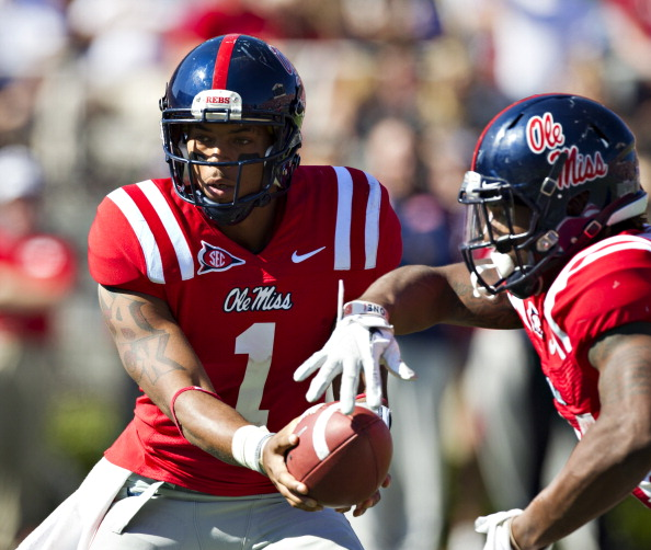 OXFORD,  MS - OCTOBER 22:  Quarterback Randall Mackey #1 of the Ole Miss Rebels makes a hand off during a game against the Arkansas Razorbacks at Vaught-Hemingway Stadium on October 22, 2011 in Oxford, Mississippi.  The Razorbacks defeated the Rebels 29 to 24.  (Photo by Wesley Hitt/Getty Images)