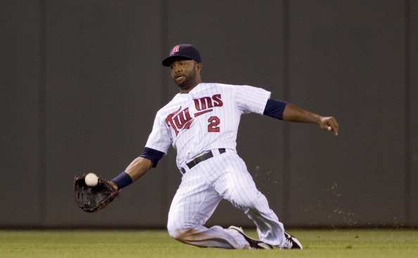 MINNEAPOLIS, MN - JULY 16: Denard Span #2 of the Minnesota Twins makes a catch in center field during the sixth inning against the Baltimore Orioles on July 16, 2012 at Target Field in Minneapolis, Minnesota. The Twins defeated the Orioles 19-7. (Photo by Hannah Foslien/Getty Images)