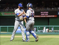 Jul 19, 2012; Washington, DC, USA; New York Mets relief pitcher Bobby Parnell (39) is congratulated by catcher Josh Thole (30) after recording the final out against the Washington Nationals at Nationals Park. Mandatory Credit: Brad Mills-US PRESSWIRE
