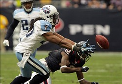 January 01, 2012; Houston, TX, USA; Tennessee Titans safety Michael Griffin (33) attempts to make an interception off a tipped pass in the third quarter against the Houston Texans at Reliant Stadium. Mandatory Credit: Troy Taormina-US PRESSWIRE