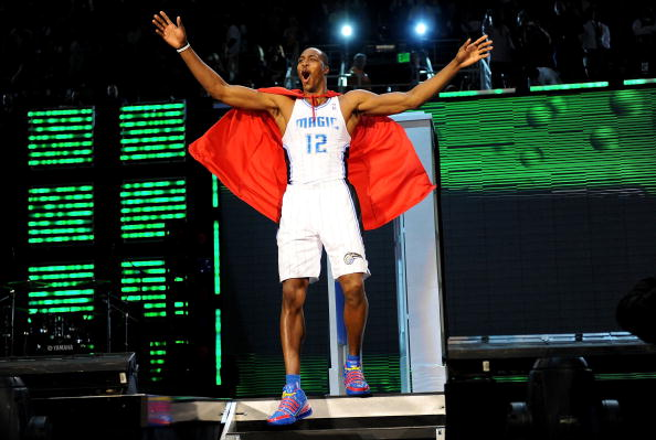 PHOENIX - FEBRUARY 14:  Dwight Howard of the Orlando Magic emerges from a phone booth wearing a Superman cape during the Sprite Slam Dunk Contest on All-Star Saturday Night, part of 2009 NBA All-Star Weekend at US Airways Center on February 14, 2009 in Phoenix, Arizona.  NOTE TO USER: User expressly acknowledges and agrees that, by downloading and or using this photograph, User is consenting to the terms and conditions of the Getty Images License Agreement.  (Photo by Ronald Martinez/Getty Images)