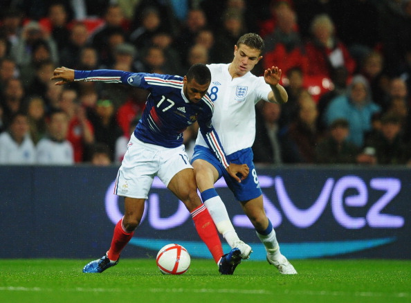 LONDON, ENGLAND - NOVEMBER 17:  Yann M'Vila (L) of France holds off the challenge of Jordan Henderson (R) of England during the international friendly match between England and France at Wembley Stadium on November 17, 2010 in London, England.  (Photo by Laurence Griffiths/Getty Images)