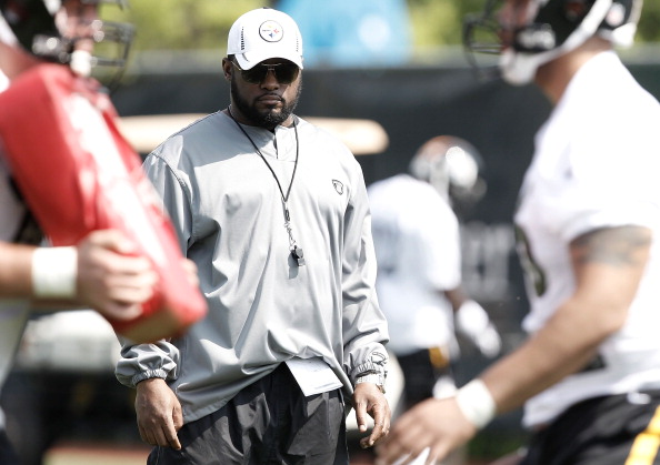 PITTSBURGH, PA - MAY 04:  Head coach Mike Tomlin of the Pittsburgh Steelers watches the players work out during their rookie minicamp at the Pittsburgh Steelers South Side training facility on May 4, 2012 in Pittsburgh, Pennsylvania.  (Photo by Jared Wickerham/Getty Images)