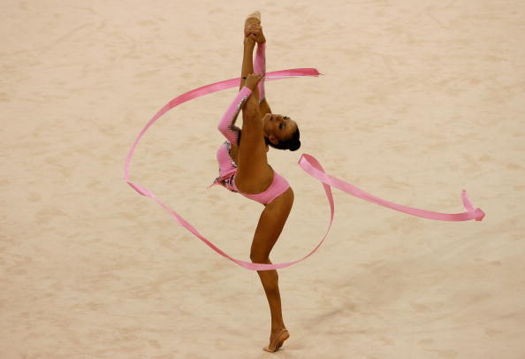 BEIJING - AUGUST 23:  Evgeniya Kanaeva of Russia competes in the Individual All-Around final held at the University of Science and Technology Beijing Gymnasium on Day 15 of the Beijing 2008 Olympic Games on August 23, 2008 in Beijing, China.  (Photo by Harry How/Getty Images)