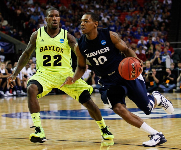 ATLANTA, GA - MARCH 23:  Mark Lyons #10 of the Xavier Musketeers drives against A.J. Walton #22 of the Baylor Bears during the 2012 NCAA Men's Basketball South Regional Semifinal game at the Georgia Dome on March 23, 2012 in Atlanta, Georgia.  (Photo by Kevin C. Cox/Getty Images)