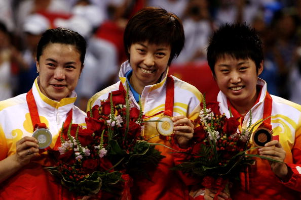 BEIJING - AUGUST 22:  (L-R) Silver medalist Wang Nan of China, gold medalist Zhang Yining of China and bronze medalist Guo Yue of China stand on the podium during the medal ceremony for the Women's Singles Table Tennis Final held at the Peking University Gymnasium on Day 14 of the Beijing 2008 Olympic Games on August 22, 2008 in Beijing, China.  (Photo by Jonathan Ferrey/Getty Images)