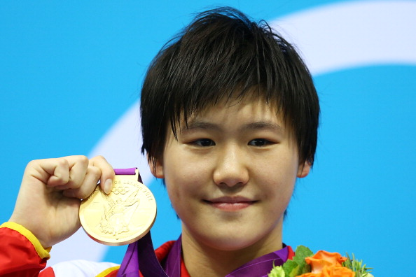 LONDON, ENGLAND - JULY 28:  Shiwen Ye of China celebrates with her gold medal during the Medal Ceremony for the Women's 400m Individual Medley on Day 1 of the London 2012 Olympic Games at the Aquatics Centre on July 28, 2012 in London, England.  (Photo by Al Bello/Getty Images)