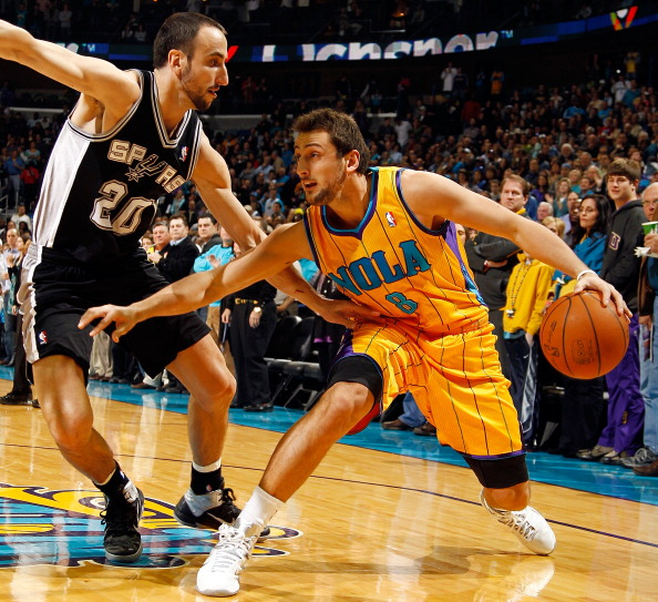 NEW ORLEANS, LA - JANUARY 22:  Marco Belinelli #8 of the New Orleans Hornets drives the ball around Manu Ginobili #20 of the San Antonio Spurs at the New Orleans Arena on January 22, 2011 in New Orleans, Louisiana.  NOTE TO USER: User expressly acknowledges and agrees that, by downloading and/or using this photograph, User is consenting to the terms and conditions of the Getty Images License Agreement.  (Photo by Chris Graythen/Getty Images)