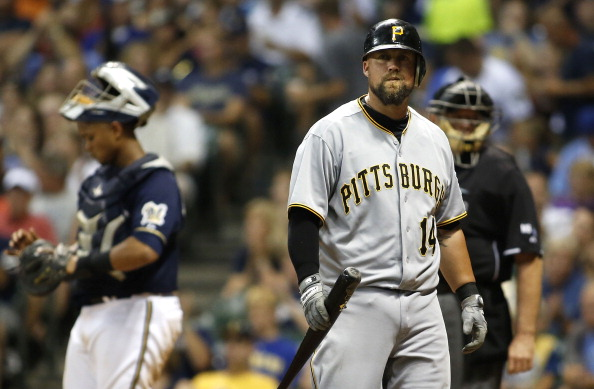 MILWAUKEE, WI - JULY 13:   Casey McGehee #14 of the  Pittsburgh Pirates walks away from the plate after striking out in the 7th inning of their game against the Milwaukee Brewers at Miller Park on July 13, 2012 in Milwaukee, Wisconsin. The Brewers defeated the Pirates 10-7.(Photo by Mark Hirsch/Getty Images)