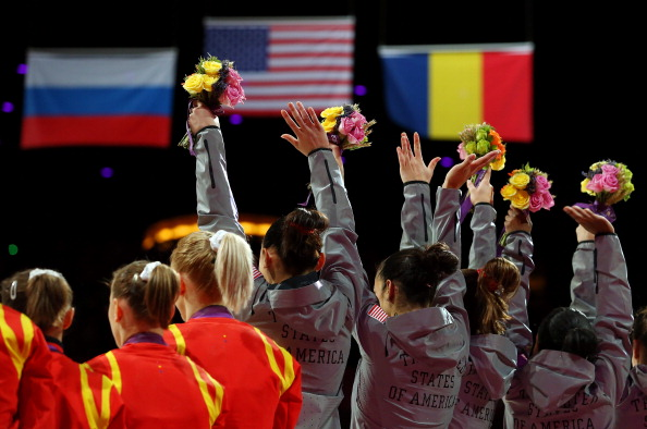 LONDON, ENGLAND - JULY 31:  The United States celebrate after winning the gold medal in the Artistic Gymnastics Women's Team final on Day 4 of the London 2012 Olympic Games at North Greenwich Arena on July 31, 2012 in London, England.  (Photo by Ronald Martinez/Getty Images)