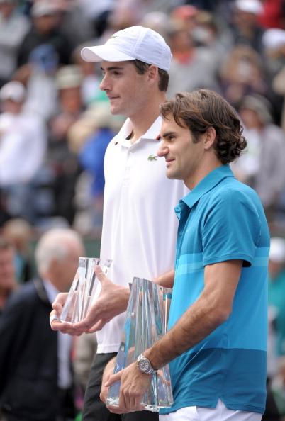 INDIAN WELLS, CA - MARCH 18:  Roger Federer of Switzerland and John Isner pose with trophies after a 7-6(7), 6-3 Federer win over Isner during the ATP Singles Final at the Indian Wells Tennis Garden on March 18, 2012 in Indian Wells, California.  (Photo by Harry How/Getty Images)
