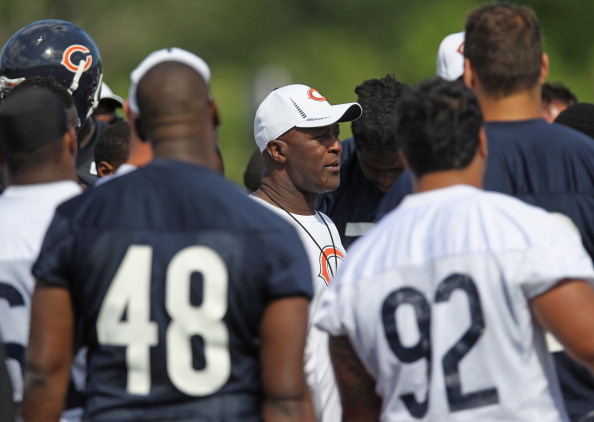 LAKE FOREST, IL - JUNE 12:  Head coach Lovie Smith of the Chicago Bears talks to players following a minicamp practice at Halas Hall on June 12, 2012 in Lake Forest, Illinois.  (Photo by Jonathan Daniel/Getty Images)